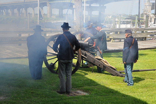 150th Anniversary of the Burning of Darien GA Civil War Sesquicentennial Union Reenactors Firing Canon Crew from Fort McAllister State Park Picture Image Photograph © Brian Brown Vanishing Coastal Georgia USA 2013