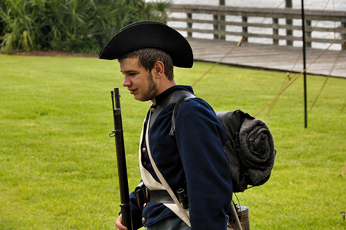 150th Anniversary of the Burning of Darien GA Civil War Sesquicentennial Young Reenactor in Uniform by River Picture Image Photograph © Brian Brown Vanishing Coastal Georgia USA 2013