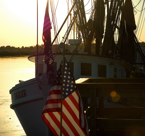 Shrimp Boat at Sunset American Flag Darien River GA McIntosh County Photograph Copyright Brian Brown Vanishing Coastal Georgia USA 2014